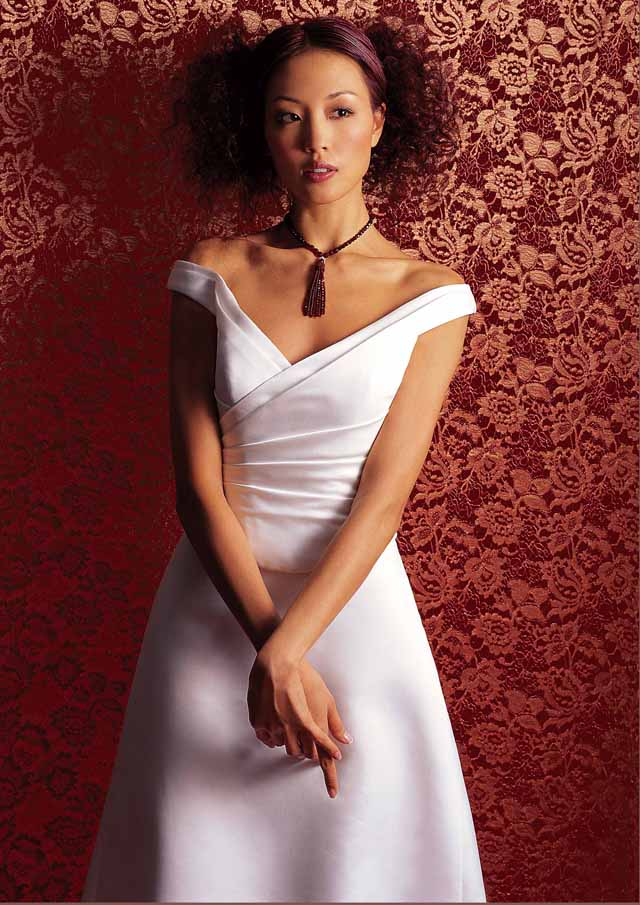 Here is a photo of Eunis in a wedding dress