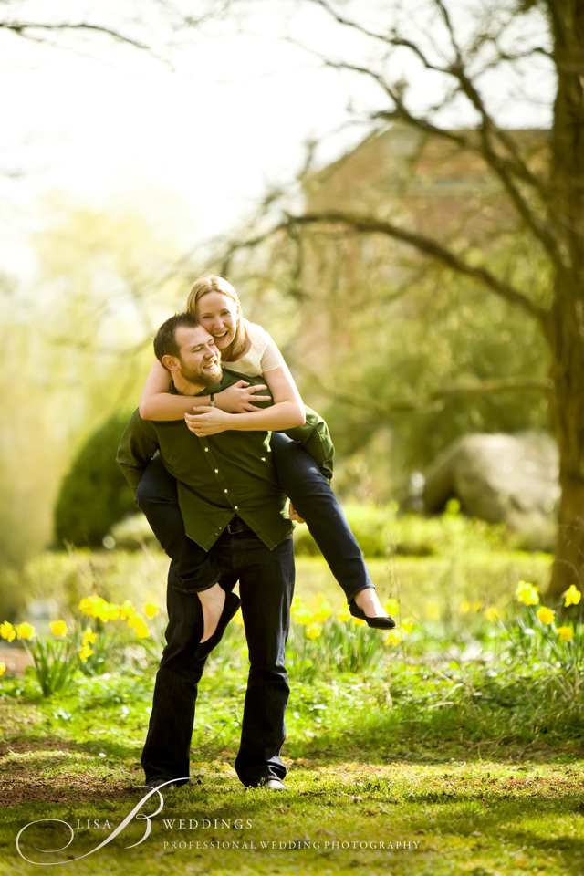 photo of engaged couple having fun in garden