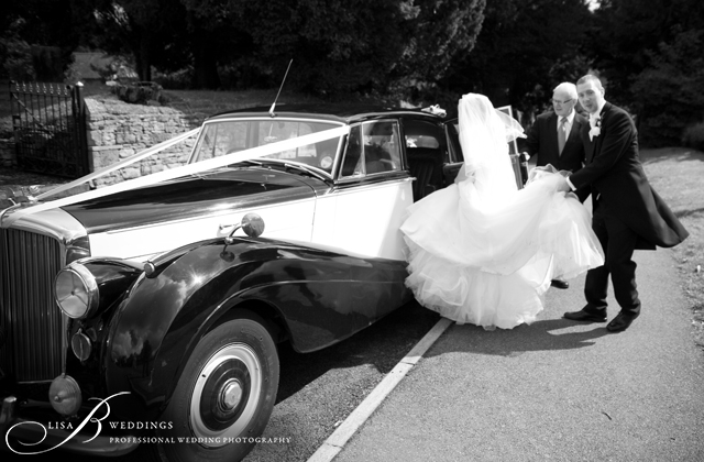 Abby-Steve-getting-in-Bridal-car-by-Lisa-B-Weddings-