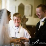 Exchanging-of-wedding-rings-in-Northants-church-by-Lisa-B