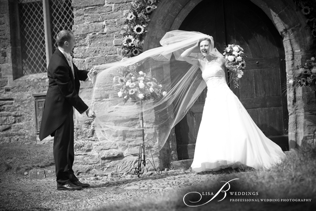 Veil-blowing-in-wind-outside-Daventry-Church-by-Lisa-B