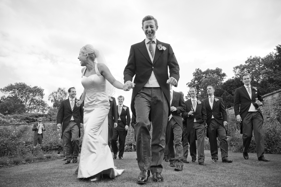 bride-and-groom-followed-by-guests