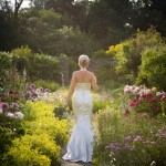 bride-walking-trough-garden