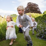 children-playing-in-garden-at-wedding