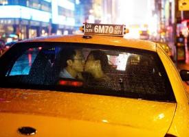 photo of Bride and Groom in back of taxi
