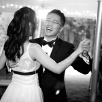Photo of groom laughing during first dance
