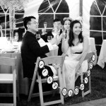 Black and white Photo with Just Married sign on backs of chairs
