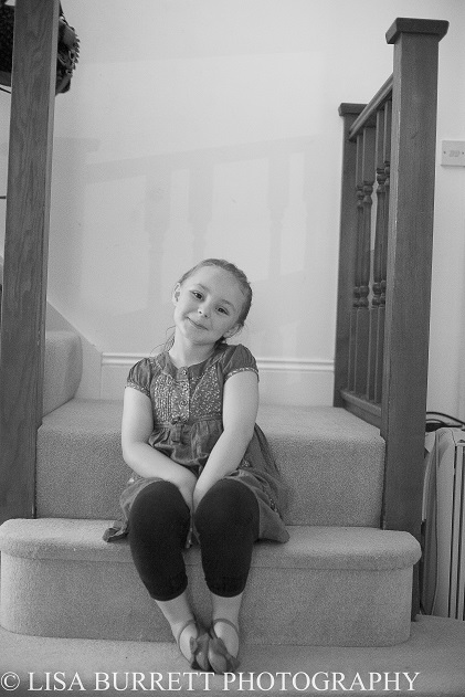 Gorgeous little bridesmaid excited before the wedding kicks off