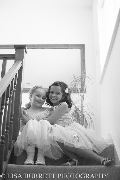 Bridesmaids cuddling on the stairs at Northampton wedding