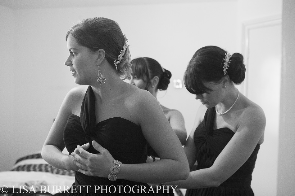 Bridesmaids getting dressed before the ceremony
