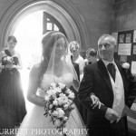 Bride walking into church with her Dad