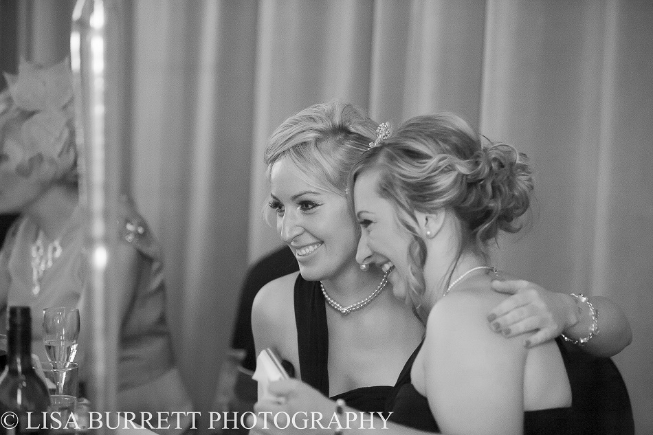Gorgeous girls laughing during wedding speeches