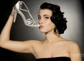 Young woman kissing shoe